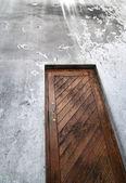 Wooden door and grimy wall — Stock Photo