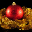 Red christmas ball and gold tinsel — Stock Photo #2169789