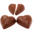 Chocolate sweets in form heart - Stock Photo