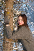 Beautiful girl in winter forest — Stok fotoğraf