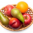 Wicker basket with fruit - Stock Photo