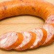 Stock Photo: Cut smoked sausage on wooden board