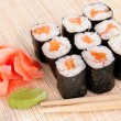 Stock Photo: Sushi rolls on mat with chopsticks