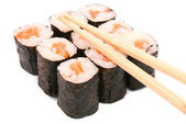 Sushi rolls in group with chopsticks — Stock Photo
