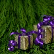 Stock Photo: Christmas gifts on green background