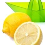 Fresh lemons and lemon juicer isolated — Stock Photo #2481353