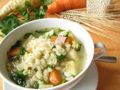 Vegetable soup with barley grains — Stock Photo