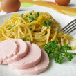 Pasta with egg and turkey pork sausa — Stock Photo