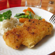 Pork cutlet with vegetables and rice — Stock Photo