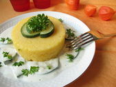 Polenta with zucchini cream cheese sauce — Stock Photo