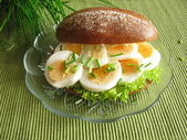 Little rye bread with egg — Stock Photo
