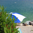 Umbrella on beach — Stock Photo