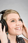 Young woman with headphones — Стоковое фото