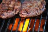Flaming meat — Stock Photo