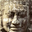 Stone face of Bayon - Stock Photo