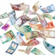 Flying money from around the world — Stock Photo