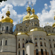 White church with golden domes — Stock Photo