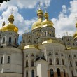 White church with golden domes - Stock Photo