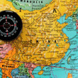 Compass on china. — Stock Photo