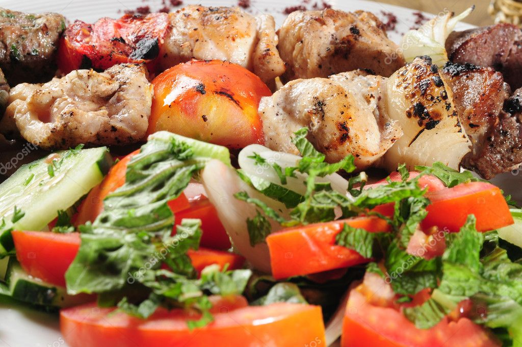 Shish kebab on pita bread. — Stock Photo #2217032