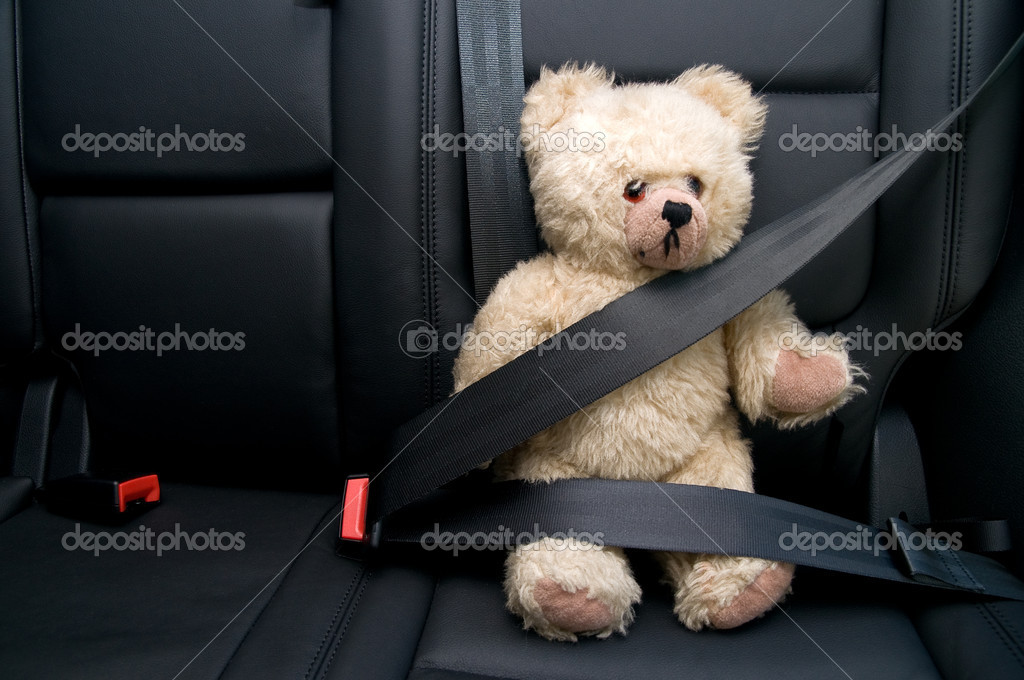Teddy Bear buckled with safety belt in a car — Stock Photo #2120586