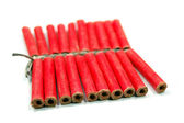 Red small firecrackers with small fuse — Stock Photo