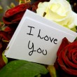 Bouquet of roses with i love you card - Stock Photo