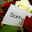 Bouquet of roses with apology card - Stock Photo