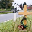 Crucifix near the road — Stock Photo