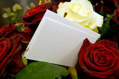 Roses with blank card to fill out — Stock Photo