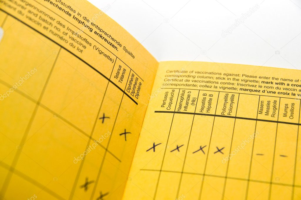 Yellow international vaccination record book  Stock Photo #2189370