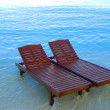 Royalty-Free Stock Photo: Canvas chairs on the beach