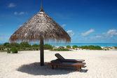 Sunshade with deckchair — Stock Photo