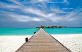 Jetty on a tropical beach — Stok fotoğraf