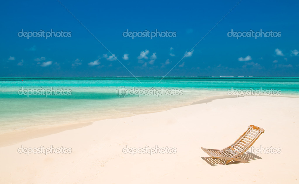 Canvas Chair on a tropical beach — Stock Photo #2531268