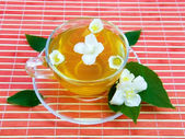 Transparent cup with jasmin tea — Stock Photo