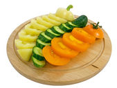 Yellow tomato, pepper and cucumber — Stock Photo