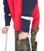 Man walking with a crutch — Stock Photo