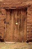 Old damaged door — Stock Photo