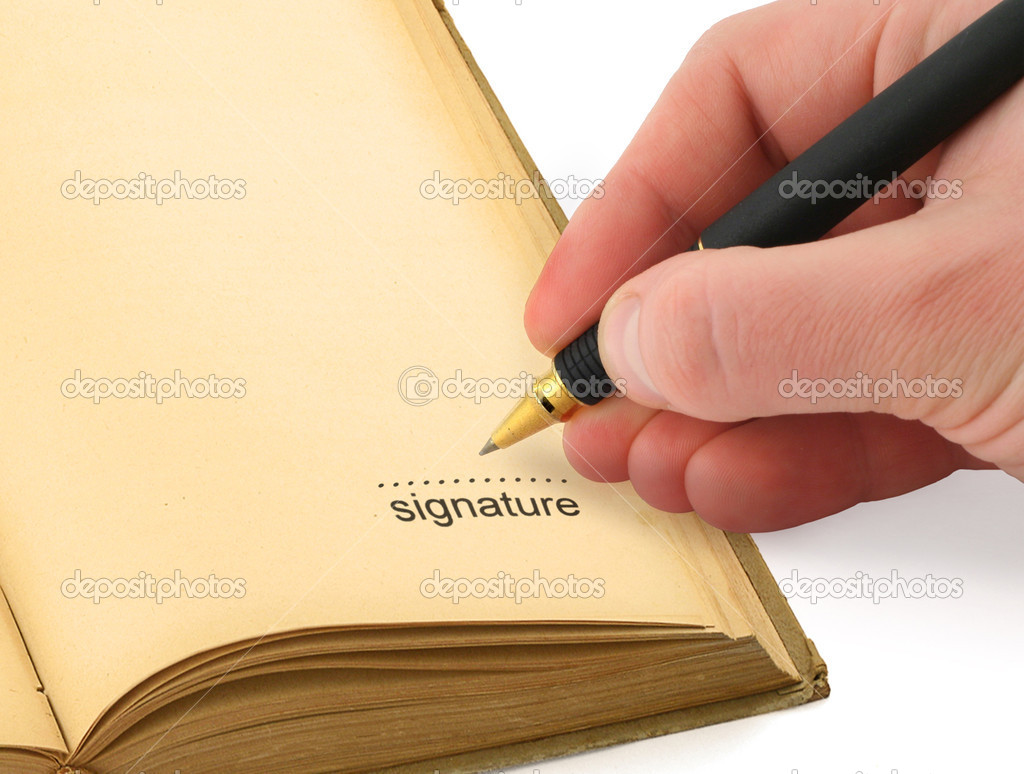 Hand writing a signature in a book  Stock Photo #2185397
