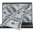 Wide notebook with dollars - Stock Photo