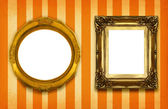 Two hollow gilded frames — 图库照片