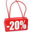 Red leather handbag with sale sign — Stock Photo
