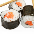 Sushi and chopsticks on white — Stock Photo