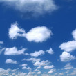 Stock Photo: Summer sky with cumulus clouds