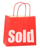 Bag with white sold sign — Stock Photo