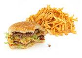 Half-eaten hamburger and french fries — Stock Photo