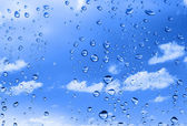 Water drops against summer sky — Stock Photo