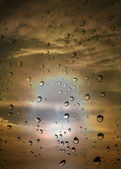Water drops against summer sunset — Stock Photo