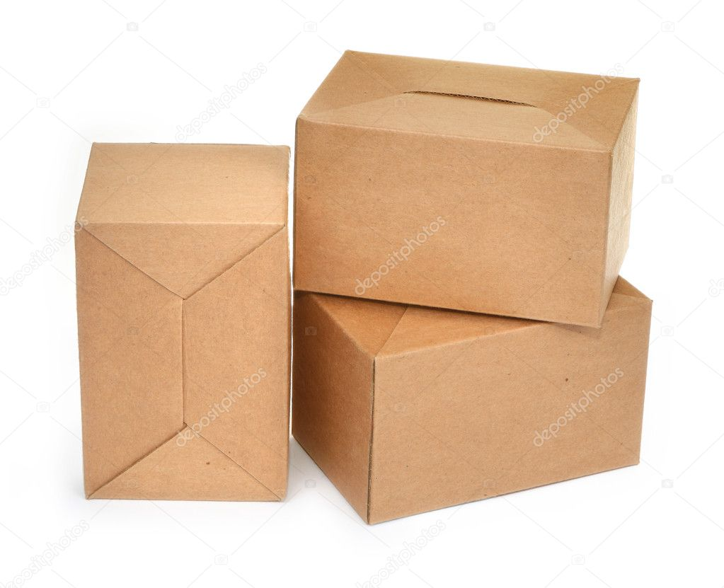 Close-up of three cardboard boxes againt white background, minimal natural shadow in front — Stockfoto #2218578
